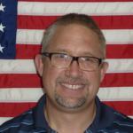 Pastor Eric Collom